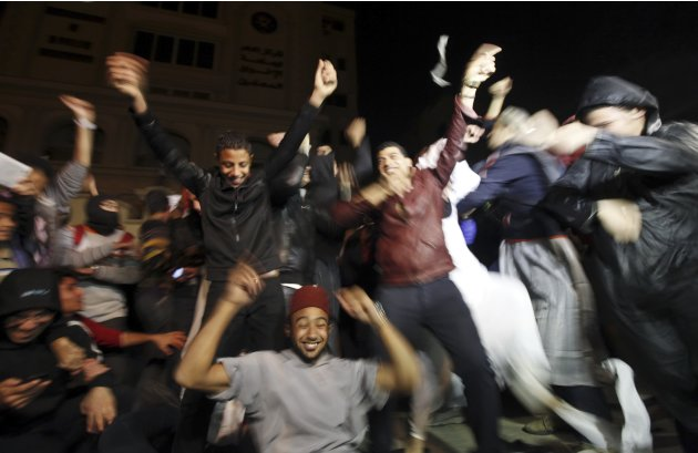 "Activists against Egyptian President Mursi perform the ""Harlem Shake"" in front of the Muslim Brotherhood's headquarters in Cairo"