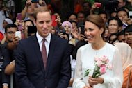 <p>Britain's Prince William and his wife Catherine, the Duchess of Cambridge, walk in the gardens of the KLCC in Kuala Lumpur on September 14. A French magazine has said it will publish topless pictures of Kate on Friday, in a move met with dismay by the royal couple</p>