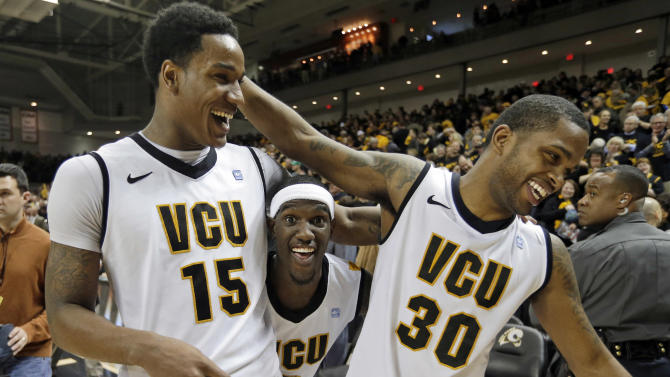 Virginia Commonwealth forward Juvonte Reddic (15), Briante Weber, center, and Troy Daniels (30), celebrate their 84-52 win over Butler in an NCAA college basketball game in Richmond, Va., Saturday, March 2, 2013.  (AP Photo/Steve Helber)