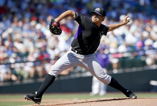 Colorado Rockies's Jorge De La Rosa throws a pitch against the Chicago Cubs during the first inning of a spring training baseball game on Tuesday, March 11, 2014, in Mesa, Ariz