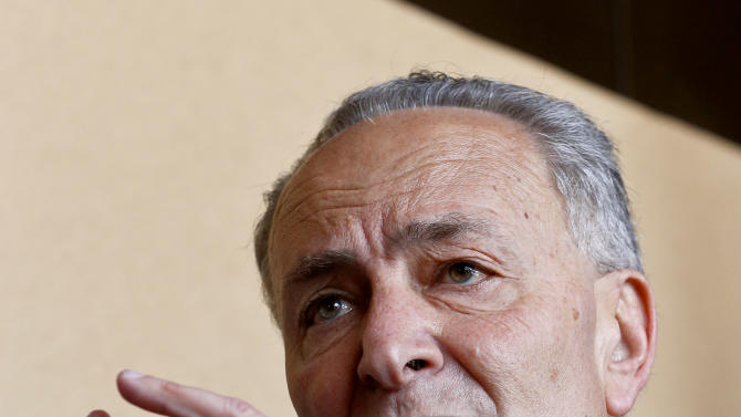Sen. Chuck Schumer, D-N.Y., makes a point as he is joined by Sen. John McCain, R-Ariz., Sen. Jeff Flake, R-Ariz., and Sen. Michael Bennett, D-CO, during a news conference after their tour of the Mexico border with the United States on Wednesday, March 27, 2013, in Nogales, Ariz.  A group of influential U.S. senators shaping and negotiating details of an immigration reform package vowed Wednesday to make the legislation public when Congress reconvenes next month. (AP Photo/Ross D. Franklin)