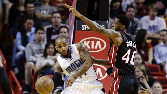 FILE - In this March 6, 2013, file photo, Miami Heat's Udonis Haslem (40) defends against Orlando Magic's Jameer Nelson (14) during the first half of an NBA basketball game in Miami. The Heat won 97-96. Winners of 20 games in a row, the Heat could be headed toward history. The Magic, who host the Heat on March 25, are one team looking for their opportunity to stop the streak. (AP Photo/J Pat Carter, File)