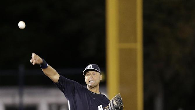New York Yankees shortstop Derek Jeter (2) tosses the ball to first between innings in a spring training baseball game against the Philadelphia Phillies in Tampa, Fla., Wednesday, March 13, 2013.  (AP Photo/Kathy Willens)