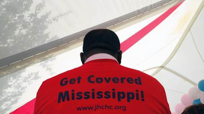 Supporters of the Affordable Care Act gather outside the Jackson-Hinds Comprehensive Health Center in Jackson, Mississippi