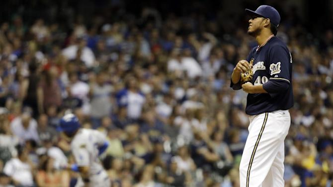 Milwaukee Brewers starting pitcher Yovani Gallardo reacts as Los Angeles Dodgers' Matt Kemp rounds the bases after Kemp hit a home run during the sixth inning of a baseball game Monday, May 20, 2013, in Milwaukee. (AP Photo/Morry Gash)