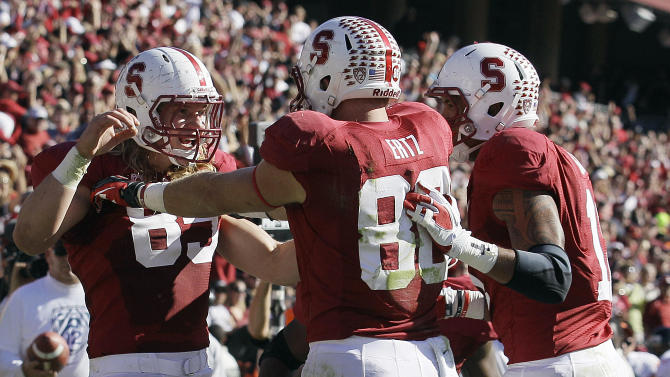 Stanford fullback Ryan Hewitt, left, celebrates with tight ends Zach Ertz (86) and Levine Toilolo after scoring on a 12-yard touchdown reception during the first quarter of an NCAA college football game against Oregon State in Stanford, Calif., Saturday, Nov. 10, 2012. (AP Photo/Jeff Chiu)