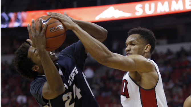 Utah State guard JoJo McGlaston (24), left, is shut down by UNLV guard Rashad Vaughn (1) during the NCAA basketball game at the Thomas & Mack Center Saturday, Jan. 24, 2015, in Las Vegas. (  (AP Photo/The Sun, Steve Marcus) LAS VEGAS REVIEW-JOURNAL OUT