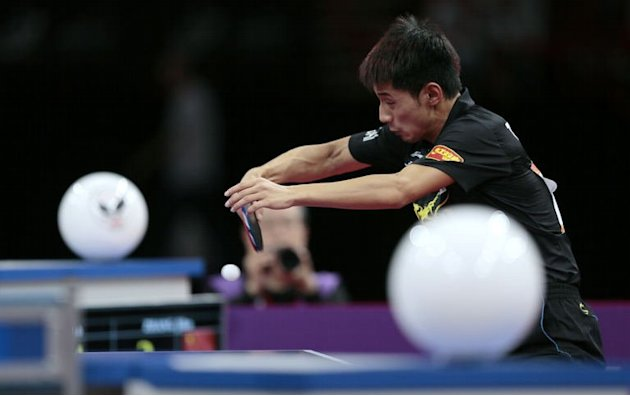 China's Zhang Jike returns a ball to China's Wang Hao on May 20, 2013 in Paris