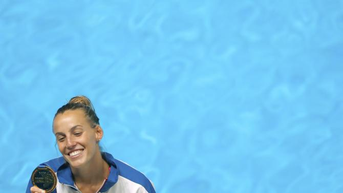Italy's Cagnotto poses with gold medal after winning women's 1m springboard finals at Aquatics World Championships in Kazan