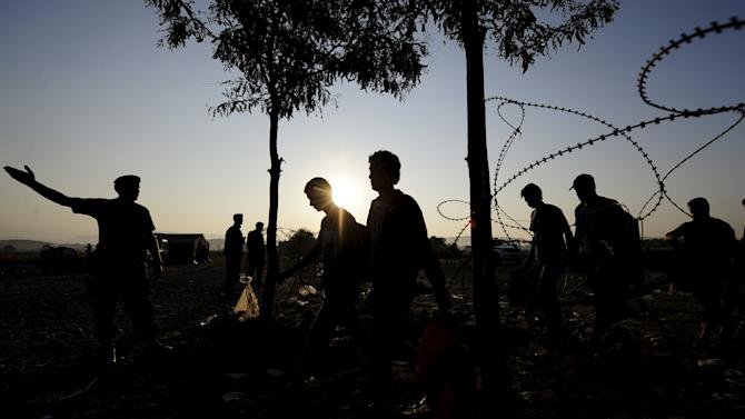 Migrants enter Macedonia near Gevgelija after crossing the border with Greece
