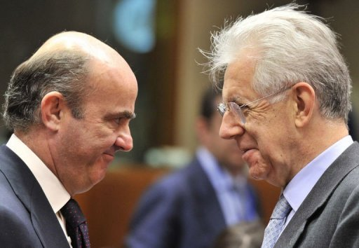 <p>Italian Prime Minister and Finance Minister Mario Monti (R) talks to Spanish Finance Minister Luis De Guindos and prior to an ECOFIN council at EU Headquarters in Brussels on July 10. Monti will step down as finance minister and the current deputy minister Vittorio Grilli will take his place, the government said on Wednesday.</p>