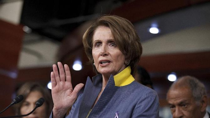 House Minority Leader Nancy Pelosi of Calif., accompanied by fellow House Democrats, gestures during a news conference on Capitol Hill in Washington, Wednesday, May 16, 2012, to discuss their fight with Republicans over the Violence Against Women Act.  (AP Photo/J. Scott Applewhite)