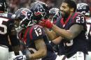 After throwing a touchdown reception to C.J. Fiedorowicz, Houston Texans running back Arian Foster (23) celebrates against the Baltimore Ravens during the first half of an NFL football game Sunday, Dec. 21, 2014, in Houston. (AP Photo/Patric Schneider)
