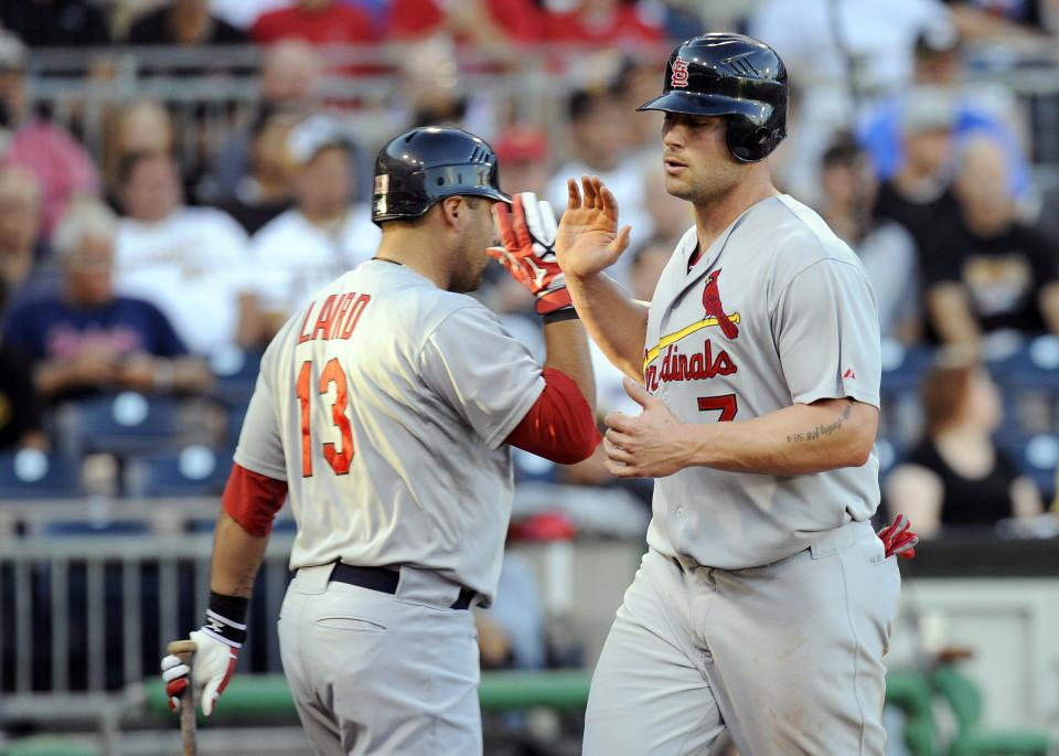St. Louis Cardinals' Matt Holliday (7) celebrates with Gerald Laird (13) after scoring on a base hit by Skip Schumaker (not pictured) during the second inning of a baseball game Tuesday, Aug. 16, 2011 in Pittsburgh.(AP Photo/Don Wright)