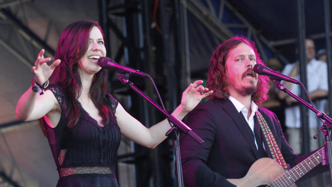 """FILE - This Oct. 14, 2012 file photo shows Joy Williams, left, and John Paul White of The Civil Wars at the Austin City Limits Music Festival in Austin, Texas. Grammy-winning duo The Civil Wars are calling off their upcoming tour dates, citing irreconcilable differences. Folk-pop duo Joy Williams and John Paul White released a statement Tuesday announcing that they are """"unable to continue as a touring entity at this time"""" due to """"internal discord and irreconcilable differences of ambition."""" Williams and White are both married, but to other people. Williams recently had a baby with husband and manager Nate Yetten. (Photo by Jack Plunkett/Invision/AP, file)"""