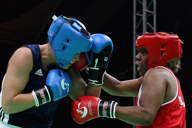Franchon Crews (Red) Of The United States Fights Against Timea Nagy (Blue) Of Hungary In The Women's 81kg Semifinals Getty Images