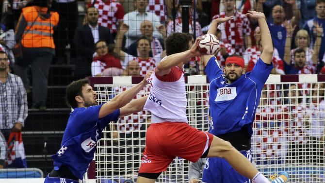 Jurecki of Poland attempts to score against Croatia during their quarterfinal match of the 24th Men's Handball World Championship in Doha