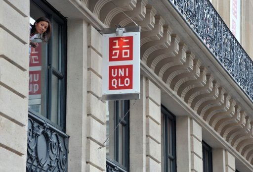 <p>File picture. An employee looks on at a Uniqlo store which opened near the Garnier Opera house in 2009 in Paris. The operator of the cheap-chic clothing giant looks set to book annual sales worth almost 1 trillion yen ($11.9 bn) this business year.</p>