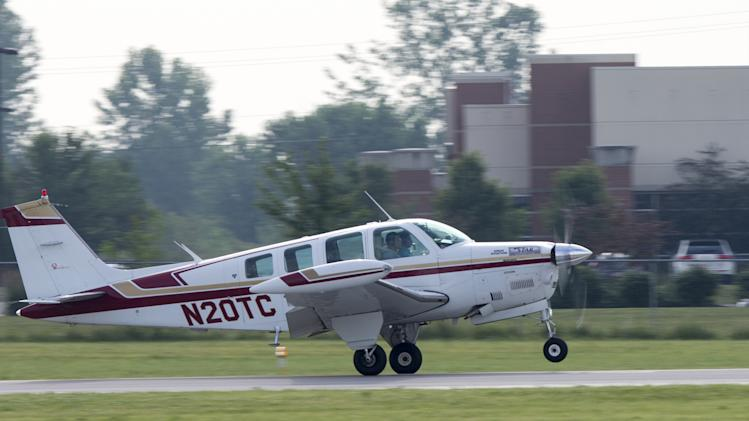 Babar Suleman and son Haris Suleman, 17, take off from an airport in Greenwood, Ind.