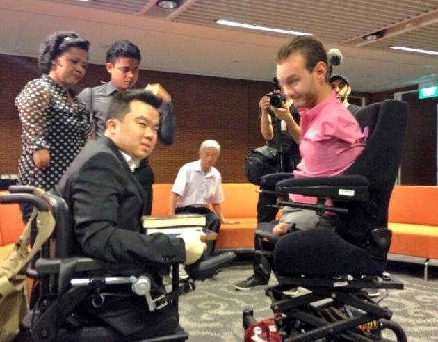 Jason Chee meets Nick Vujicic, with Aishah Samad in the background.