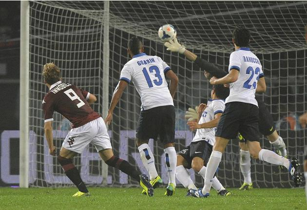 Torino's Immobile shoots to score against Inter Milan during their Italian Serie A soccer match at the Olympic stadium in Turin