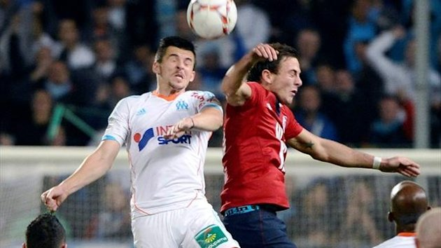 Marseille's Joey Barton vies for the ball with Lille midfielder Mathieu Debuchy (AFP