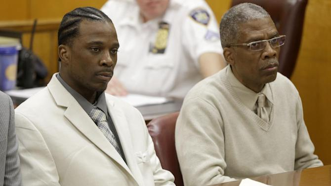 FILE - In this file photo of June 6, 2013, Vincent George Jr., left, and Vincent George Sr., listen to closing arguments in a courtroom in New York. The father and son who acknowledged they were pimps were acquitted Wednesday, June 19, 2013 of sex trafficking charges after several prostitutes testified they were treated well. A Manhattan judge found them guilty of less-serious charges of promoting prostitution and money laundering. The two hadn't denied they were pimps but insisted they never abused their prostitutes. (AP Photo/Seth Wenig, File)