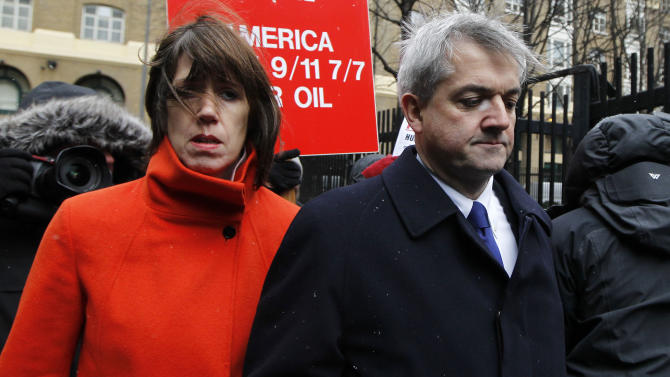 Britain's Former Energy Secretary Chris Huhne, right, and his partner Carina Trimingham arrive for his sentencing hearing on perverting the course of justice, at Southwark Crown Court in London, Monday, March 11, 2013. Huhne's last-minute guilty plea last month was a surprise — he had protested his innocence for months — and shattered his once promising political career. Huhne, 58, resigned from Parliament the same day he pleaded guilty. (AP Photo/Sang Tan)