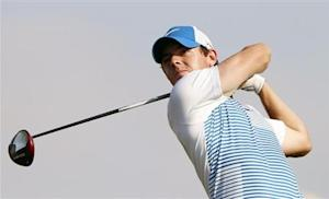 McIlroy of Northern Ireland tees off on the 15th hole during the Abu Dhabi Golf championship