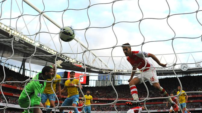 Arsenal's Welsh midfielder Aaron Ramsey scores his team's second goal during the English Premier League football match between Arsenal and Crystal Palace at The Emirates Stadium in north London on August 16, 2014