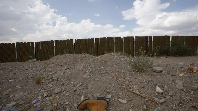 A boot lies near the fence marking the border between Mexico and the U.S. and where the Mexican state of Chihuahua and the U.S states Texas and New Mexico meet, on the outskirts of Ciudad Juarez