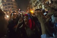 People celebrate in Cairo's Tahrir Square after the toppling of President Mohammed Morsi on July 3, 2013