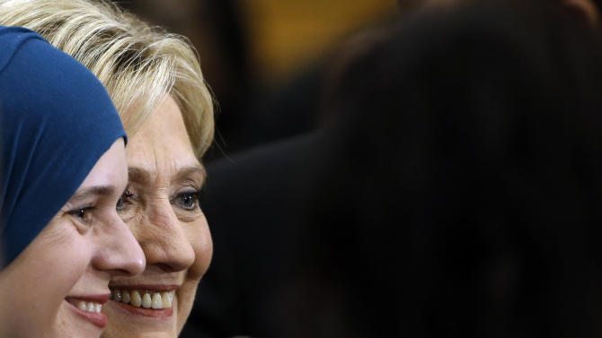 In this Feb. 3, 2016, photo, Democratic presidential candidate Hillary Clinton meets with attendees during a campaign stop in Manchester, N.H. It seems Clinton is having trouble earning the public's trust. As the Democratic presidential contest hurtles toward the New Hampshire primary Tuesday, the former secretary of state is seeking to convince voters of her authenticity as rival Bernie Sanders criticizes her Wall Street ties and questions whether she's really a liberal. (AP Photo/Matt Rourke)