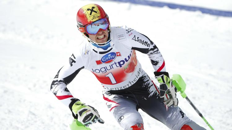 Hirscher of Austria celebrates winning the season's last race and the slalom World Cup trophy at the FIS Alpine Skiing World Cup Finals in Lenzerheide