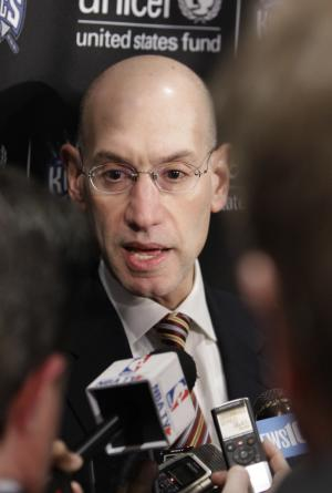 Adam Silver, the new NBA Commissioner, talks with reporters during the half time of an NBA basketball game between the Sacramento Kings and the Toronto Raptors in Sacramento, Calif., Wednesday, Feb. 5, 2014. Silver replaced David Stern Feb. 1, who retired after 30 years as the head of the NBA.(AP Photo/Rich Pedroncelli)