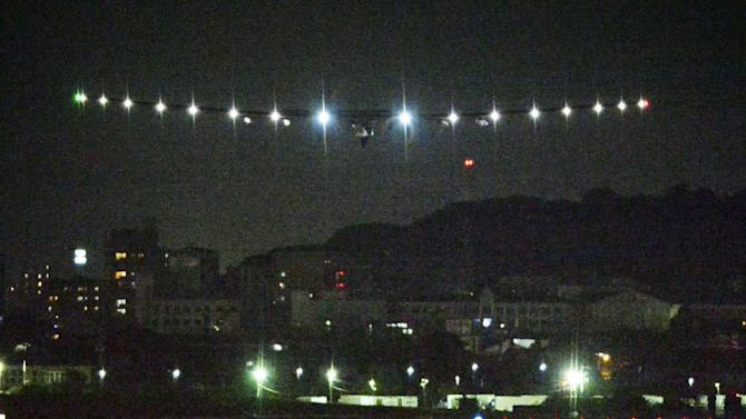 The Solar Impulse 2 approaches Nagoya Airport in Toyoyama, near Nagoya, central Japan, shortly before its landing Monday, June 1, 2015. The solar plane attempting to fly around the world without a drop of fuel made an unscheduled stop late Monday night in Nagoya because of bad weather. Swiss pilot André Borschberg took off from Nanjing, China, on Sunday on what was to be the longest leg of the journey, a six-day, 8,175-kilometer (5,079-mile) flight to Hawaii. (Takuya Inaba/Kyodo News via AP) JAPAN OUT, CREDIT MANDATORY