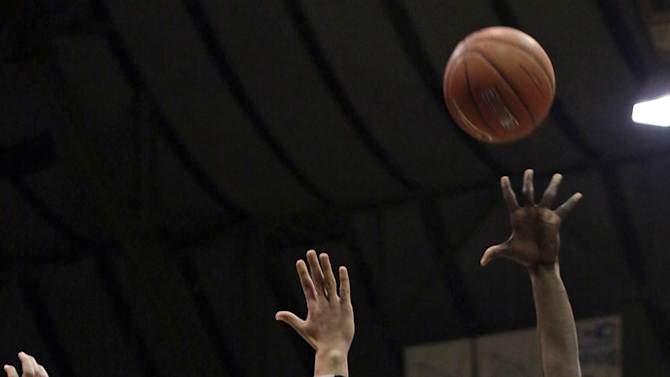 Butler forward Khyle Marshall, right shoots over Gonzaga forward Kelly Olynyk during the first half of an NCAA college basketball game Saturday, Jan. 19, 2013, in Indianapolis. (AP Photo/AJ Mast)