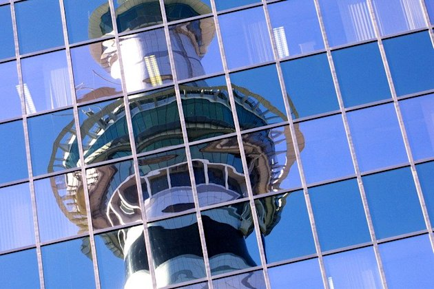 This file photo shows the 328m tall Sky Tower, reflected on a building in Auckland, on July 1, 2003