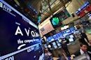 A screen displays the price for Avon Products Inc. at the post that trades the stock on the floor of the New York Stock Exchange