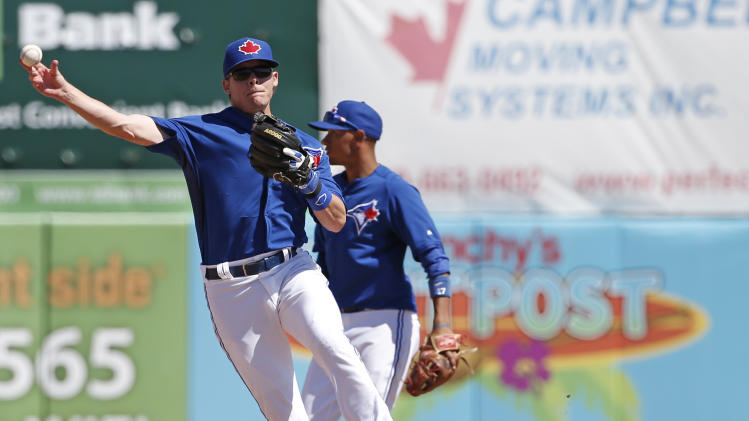 Toronto Blue Jays second baseman Chris Getz (39) throws to first for a putout in a spring exhibition baseball game against the Boston Red Sox in Dunedin, Fla., Friday, March 14, 2014. Toronto Blue Jays shortstop Ryan Goins (17) is at right. (AP Photo/Kathy Willens)