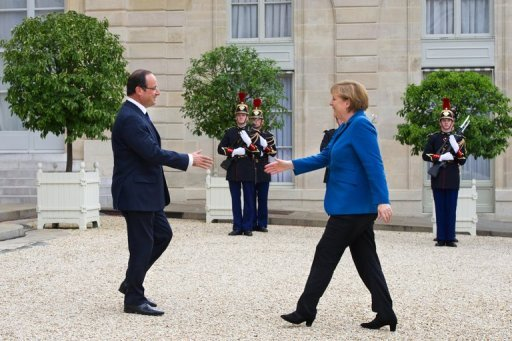"<p>France's President Francois Hollande (left) welcomes Germany's Chancellor Angela Merkel to the the Elysee presidential palace in Paris. EU leaders debate ""a big leap forward"" to strengthen their union and save the euro at a two-day summit starting Thursday, but divisions may scuttle efforts to shore up the single currency.</p>"