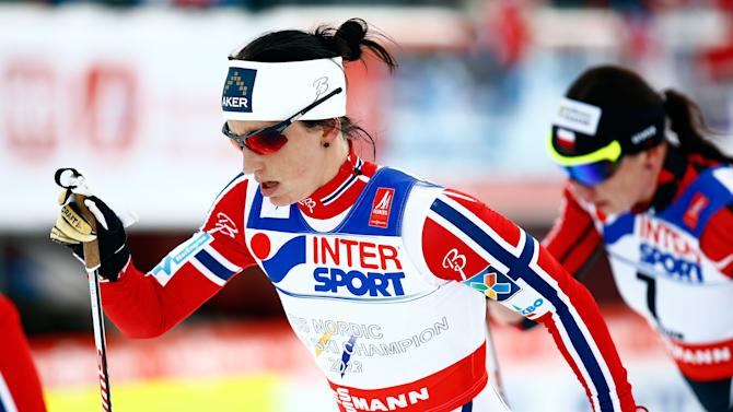 Norway's Bjoergen competes in the women's cross country 30 km mass start classic race at the Nordic World Ski Championships in Falun
