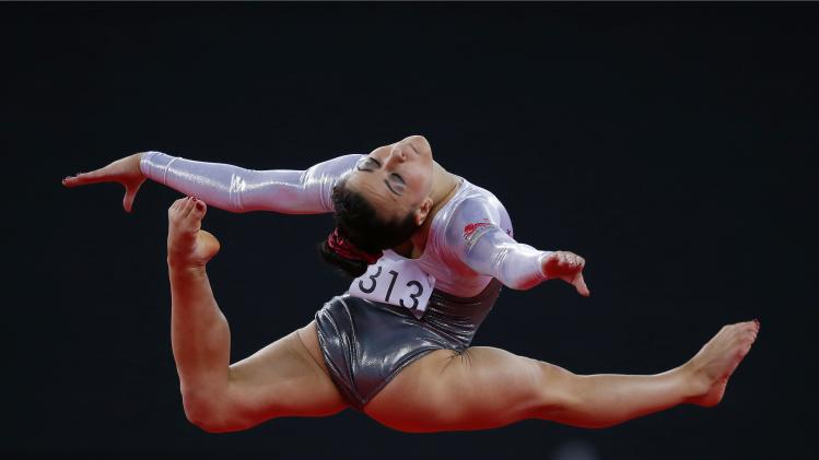 Claudia Fragapane of England performs during her floor routine in the women's gymnastics team final at the 2014 Commonwealth Games in Glasgow