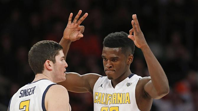 California guard Jabari Bird (23) shows three-points after shooting a three-point shot against Syracuse in the first half of an NCAA basketball game at Madison Square Garden in New York, Thursday, Nov. 20, 2014.  (AP Photo/Kathy Willens)