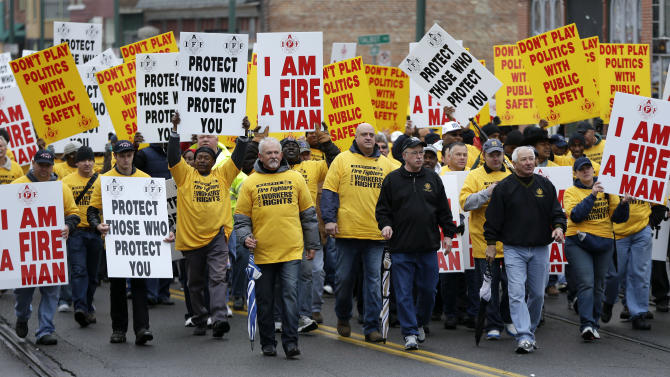 Firefighters take part in a march to the National Civil Rights Museum on Thursday, April 4, 2013, in Memphis, Tenn. Labor groups marched to call for better conditions on the 45th anniversary of the killing of Dr. Martin Luther King Jr. King was assassinated April 4, 1968, while he was in Memphis to support striking sanitation workers. (AP Photo/Mark Humphrey)