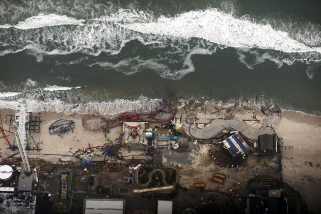 In this aerial photo, debris from an amusement park destroyed during Superstorm Sandy lines the beach in Seaside Heights, N.J. Thursday, Nov. 1, 2012.  The photo was taken during a flight to document