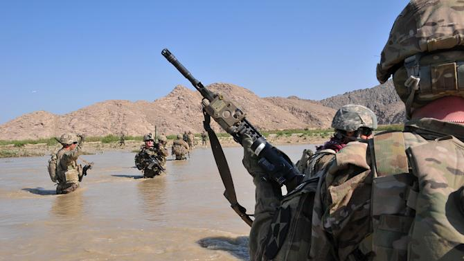 In this April 10, 2013 photo released by the U.S. Army, U.S. Soldiers with Charlie Company, 1st Battalion, 38th Infantry Regiment, 4th Brigade Combat Team, 2nd Infantry Division cross the Tarnak river in the Panjwai district of Kandahar province, Afghanistan on a two-day mission to clear the area of explosives caches. The Taliban have announced they will launch their spring offensive on Sunday, April 28, 2013, signaling plans to step up attacks as the weather warms across Afghanistan, making both travel and fighting easier.  (AP Photo/Sgt. Kimberly Hackbarth, U.S. Army)