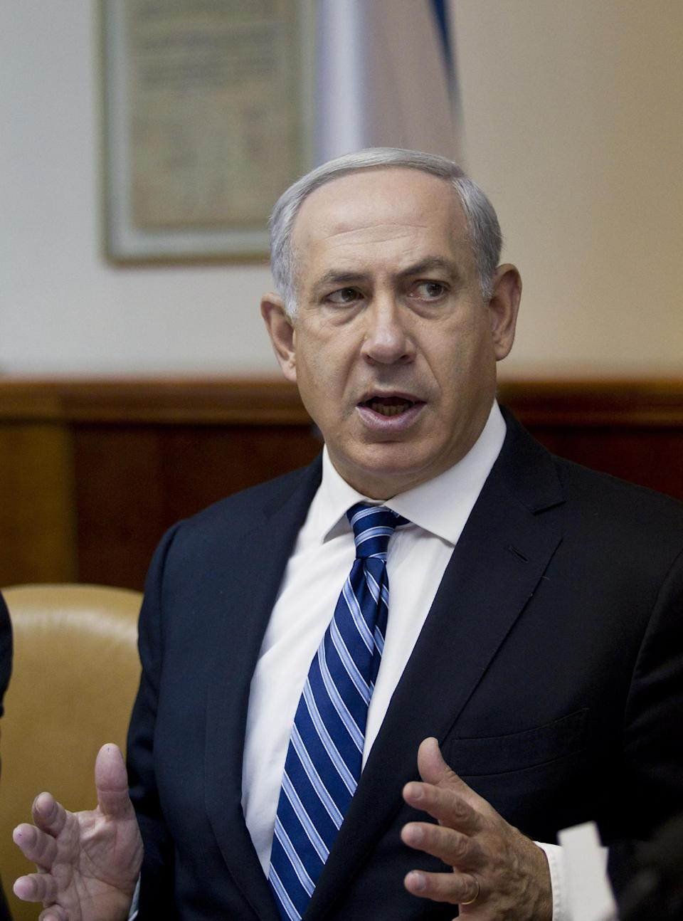 Israeli Prime Minister Benjamin Netanyahu chairs the weekly cabinet meeting in his Jerusalem offices, Sunday, Oct. 14, 2012. Israel's Cabinet has announced January 22, 2013 as the date for parliamentary elections, with Prime Minister Benjamin Netanyahu leading in the polls.(AP Photo/Jim Hollander, Pool)