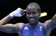 Nicola Adams of Great Britain is declared winner on points over Stoyka Petrova of Bulgaria in their women's flyweight boxing quarter-final of the 2012 London Olympic Games at the ExCel Arena, on August 6, in London