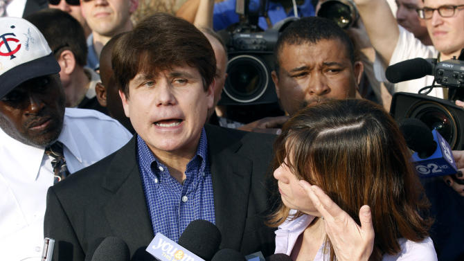 FILE - In this March 14, 2012 file photo, former Illinois Gov. Rod Blagojevich speaks to the media outside his home in Chicago, as his wife Patti wipes away her tears a day before he was to report to a prison in Littleton,. Colo., to begin a 14-year prison sentence on corruption charges. Lawyers for Blagojevich are working to meet a deadline Monday, July 15, 2013, to file what could be a 100-page appeal calling for the ex-governor's corruption convictions to be tossed or for his 14-year sentence to be reduced. (AP Photo/M. Spencer Green, File)